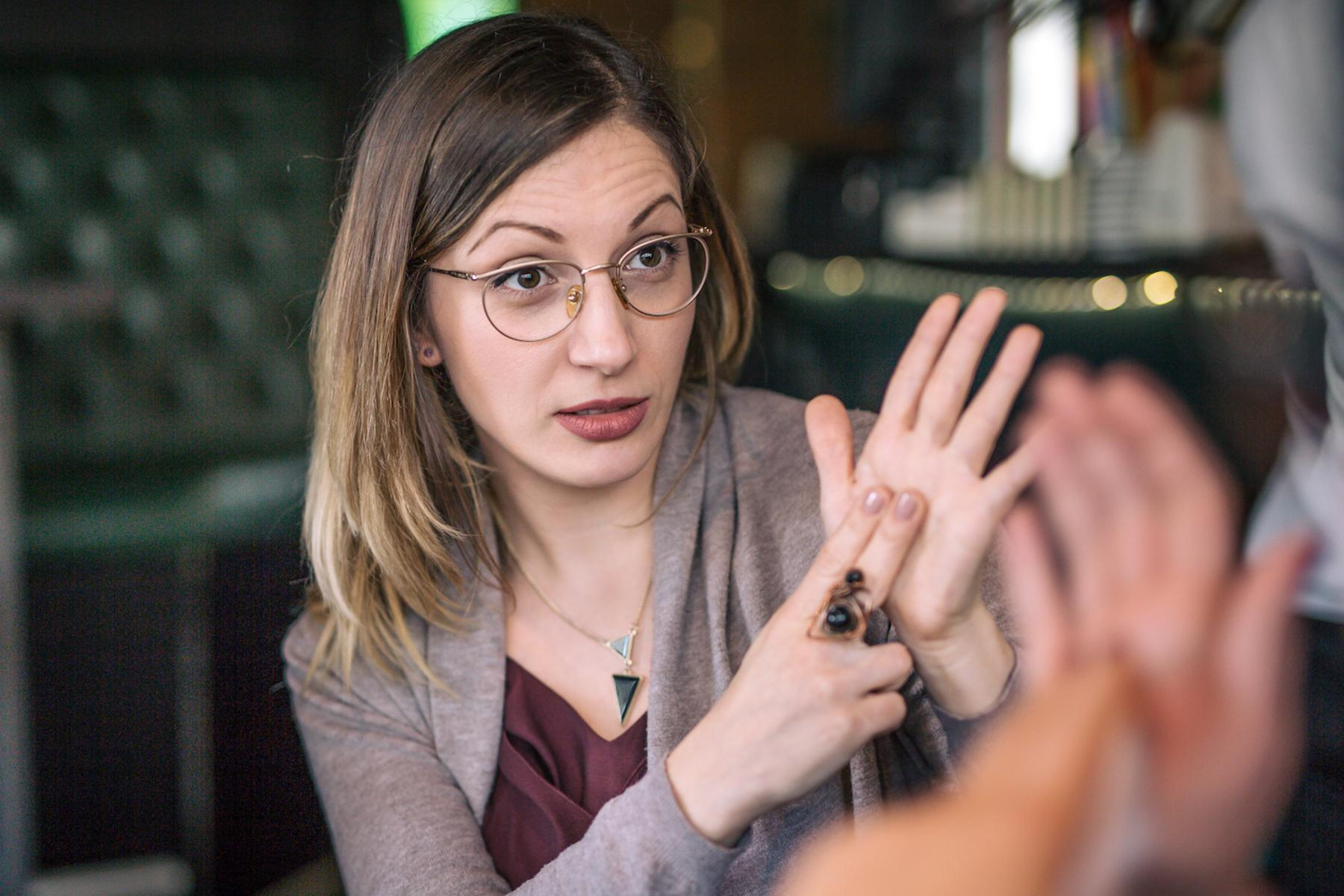 Close up picture of a woman communicating in sign language