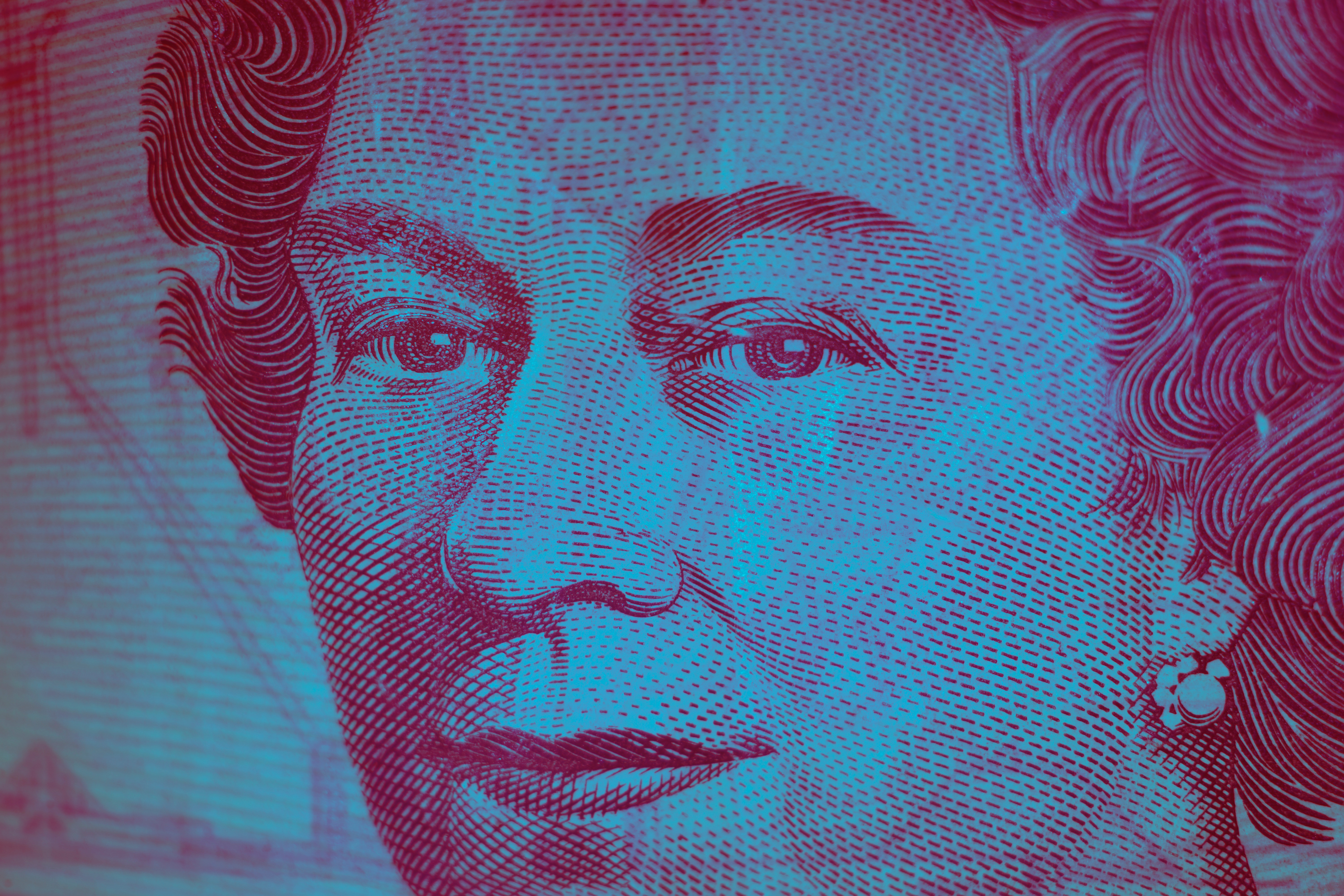 Close up of Queen of England's face on bank note